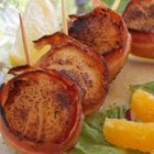Spicy Bacon-Wrapped Scallops - Cajun seasoning gives this tried-and-true combination of bacon and scallops a spicy kick. Serve it as light meal or double the recipe to serve a crowd.