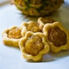 Pineapple Tarts - Delightful little tarts with pineapple filling and a cross on the top.
