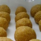 Besan Ladoo - This sweet confection from India and Pakistan combines chickpea flour, coconut, cardamom, and ground nuts.