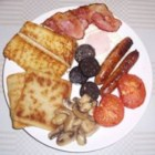 Ferg's Ulster Fry-up - In the North of Ireland, locals treat themselves to this enormous breakfast on the weekends. The fried breads make it unique. Soda bread and potato farls are cooked in reserved bacon fat making them golden and crispy. Served alongside Irish bacon, sausage, black pudding, tomato and egg - you won't need to eat again for the rest of the day!