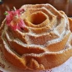 Rose Petal Pound Cake - Two flavors are swirled together in this rich pound cake: an almond batter and a pink-tinted rosewater-scented batter. It's dusted with confectioners' sugar before serving.