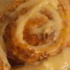 Cake Mix Cinnamon Rolls - White cake mix is the magic ingredient in these rich cinnamon yeast rolls peppered with pecans on top.