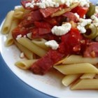 Rigatoni alla Puttanesca e Arrabbiata - Inspired by two classic Italian sauces, spicy tomato-olive-y puttanesca and arrabbiata with red pepper flakes and bacon, this dish blends both and serves them with rigatoni pasta topped with feta cheese and fresh parsley.