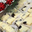 White Chocolate Cherry Fudge - White chocolate, dried cherries, and almond extract come together in this delicious and sweet fudge.