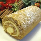Pumpkin Roll - This is a great dessert, especially nice for holidays, but it can be served anytime of the year.  The resulting pumpkin roll slices will impress your guests.  The pumpkin roll is not as hard to make as it sounds.  Be sure and use plain canned pumpkin and not pumpkin pie mix. Originally submitted to CakeRecipe.com.