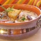 Wild Rice And Chicken Soup - You will leave the table well-sated after a bowl or two of chicken and wild rice in a heavy cream herbed broth.  Toss in a few diced pimientos for color.