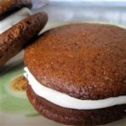 Gingerbread Whoopie Pies - These spicy whoopie pies are flavored with cinnamon, ginger, and molasses. Filled with a cream cheese frosting, they make a fun treat.