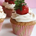 Real Strawberry Cupcakes - Pink strawberry cupcakes with cream cheese frosting get a fresh strawberry slice for garnish.