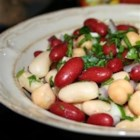 Mediterranean Three Bean Salad - Cannellini beans, garbanzo beans, and kidney beans are tossed together with a refreshing Mediterranean-inspired dressing.