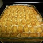 Savory Tater Tot Casserole - Ground beef is layered in a casserole with chopped onions, mixed vegetables, cream of chicken soup, and topped with tater tots. It bakes in an hour.