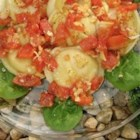 Cheese Ravioli with Fresh Tomato and Artichoke Sauce - The garden-fresh flavor of roma tomatoes is complimented by the tart notes of marinated artichokes in a delectable sauce that can be prepared in less time than it takes to cook up a package of fresh cheese ravioli.