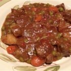 Christmas Eve Beef Stew - Here is a beef stew full of potatoes, carrots, celery and peas in a rosemary-tomato broth which is thickened with pearl tapioca.  It can be made in a slow cooker or a Dutch oven.