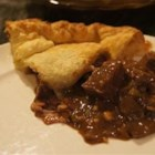 Beef, Mushroom and Guinness(R) Pie - Beef, mushrooms, and Irish stout beer simmer into a savory filling for a pot pie topped with puff pastry.