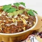 Becca's Barbequed Beans - Ground beef and pork and beans baked with onion, barbeque sauce, Worcestershire and dill pickles.