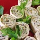 Mexican Cream Cheese Rollups - These south-of-the-border hors d'oeuvres -- with a cream cheese base -- are rolled up in tortillas, then sliced into bite-sized treasures.