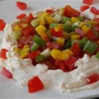 Jules' Zesty 7 Layer Dip - A creamy, spicy layer of cream cheese forms the base of this pretty layered dip that doesn't contain beans.