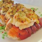 Crab Stuffed Lobster Rayna - Grilled lobster tails stuffed with celery, green onion, and crabmeat seasoned with cayenne pepper and dry mustard. Delicious served with warm garlic lemon butter.