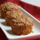 Apple Pumpkin Muffins - These muffins are extra moist because they are made with pumpkin and tender pieces of apple. Made with whole-wheat flour, these are perfect for a breakfast-on-the-go or an afternoon snack.