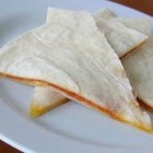 2 Minute Cheese Quesadillas - Cheddar cheese and flour tortillas are all you need for these quick and easy quesadillas. Cook in the microwave for 1 minute and lunch is served!