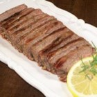 Tuscan Flank Steak - Flavorful flank steak is marinated for several hours in a marinade of lemon zest, olive oil, rosemary, and garlic, then grilled to perfection.