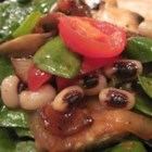 Spinach Salad with Hot Bacon Dressing - Serve up good fortune with a delicious spinach salad with black-eyed peas and a hot bacon dressing!