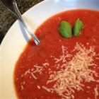 Parmesan Basil Tomato Soup - Canned tomato soup becomes homemade when you add fresh onion, garlic, basil, and grated Parmesan cheese. Add milk or water if soup is too thick.