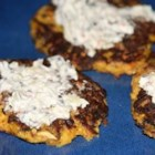 Yellow Squash Patties - Top these delicious, cheesy squash patties with sour cream and a dash of hot sauce. Everyone will love them!