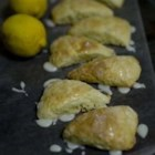Amazing Lemon Scones - Lemony scones are topped with a simple glaze and are perfect for brunch or a snack.