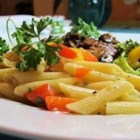 Penne Pasta with Peppers - Colorful red and yellow sweet bell peppers sauteed with sliced red onions and chopped garlic are poured over cooked penne to make a cheerful dish of pasta.
