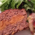 Ribbon Meatloaf - Beautifully mellow in flavor, this meatloaf has a ribbon of cheese flowing through the middle of it.