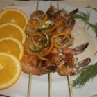 Spicy Shrimp Skewers - Sweet, tangy, and spicy, these shrimp skewers are a hit when served over seasoned rice alongside margaritas!