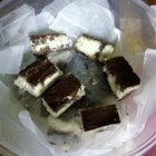 Choco-coconut Bars - This recipe is very similar to the Mounds candy bar. With few ingredients, it is surprisingly easy to make.