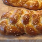 Most Amazing Challah - This recipe for challah makes 2 big loaves or 4 regular-sized ones. It gets a single rise, and uses an easy 3-strand braid. The tops get a shiny egg wash and a generous sprinkling of sesame seeds before baking.