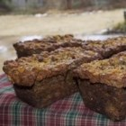 Powerhouse Banana Bread - A hearty recipe for whole wheat banana bread is packed with dates, walnuts, and optional coconut for a great take-along breakfast or part of a morning meal that will stick to you all day long. Sour cream keeps it moist, and brown sugar and cinnamon make it yummy. Recipe makes 4 loaves.