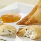 Crab Rangoon Puffs - Crescent roll dough is filled with a mixture of crab meat, cream cheese, and cocktail sauce, then baked to a golden brown. This is a tasty treat that has a flavor similar to Crab Rangoon. These crab puffs are a great appetizer for any occasion. You may want to make a second batch!