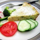 Zucchini Quiche - This is a simple quiche recipe for which you probably already have everything you'll need!  Biscuit mix and eggs are the key, along with zucchini, of course!