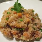 Quinoa Pilaf - A delicious and easy quinoa pilaf with sauteed onions, carrots, and walnuts. Served with a salad and crusty bread, this pilaf makes for a complete meal.