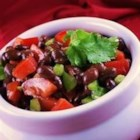 Cold Black Bean Salad - Cold black bean salad with a bite!  It makes a great side dish for any Mexican or Southwestern dish. This recipe has become a healthy favorite in our family. Adjust the amount of serrano pepper to suit your spice tolerance.