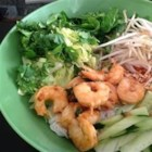 Vermicelli Noodle Bowl - Many Vietnamese dishes are perfect for hot weather. This simple noodle salad combines fresh herbs, rice vermicelli, cucumber, bean sprouts, and more, topped with grilled shrimp. Tossed with a tangy sweet and sour sauce, it's a simple and satisfying dinner.