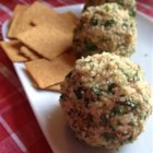 Salmon Cheese Ball - Walnuts and parsley form the outer layer to this beautiful and addicting salmon and cream cheese ball. Horseradish livens up the mixture.