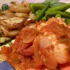 Cod in Tomatoes with Wine - Cod loin and large prawns are simmered in an herbed tomato and wine sauce for a quick dinner ready in under an hour. Serve with vermicelli noodles, new potatoes, or a green salad.