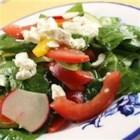 New Twist To An Old Favorite - Crisp, crunchy and alive with fresh garden taste, this colorful spinach salad features ripe tomatoes, cucumbers, radishes and red bell pepper with a salty sprinkling of feta cheese.