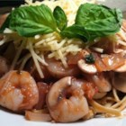 Shrimp Pasta with Tomato Basil Sauce - Mushrooms, tomatoes, and basil simmer with red wine and a splash of lemon juice to make a light sauce for shrimp and linguine.