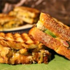 Chicken Pesto Paninis - A delicious mix of chicken, pesto, veggies, and cheese all melted together on flavorful focaccia bread. Simple, fast, and very tasty - a nice change from normal sandwiches.