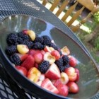 Rainbow Fruit Salad - The flavor of fresh fruit speaks for itself in this simple salad composed of watermelon, cantaloupe, pineapple, blueberries, plums and green and purple grapes.
