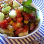 Grandma's Sweet and Tangy Bean Salad - This crunchy bean salad is tossed with celery, green peppers, and cucumbers and coated with a vinegar-based dressing for a perfect picnic salad.