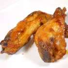 Big Game Hot Wings - Sweet and spicy baked chicken wings are coated with a zesty sauce flavored with an orange.