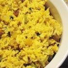 Rice Pilaf with Raisins and Veggies - This savory rice dish is dotted with sweet golden raisins for a light fruity flavor.