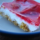 Strawberry Pretzel Salad - A cool strawberry gelatin salad with a cream cheese middle and pretzel crust.