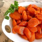 Bourbon Glazed Carrots - Sweet carrots are drizzled with a buttery bourbon glaze for a warm side dish for the holiday table.